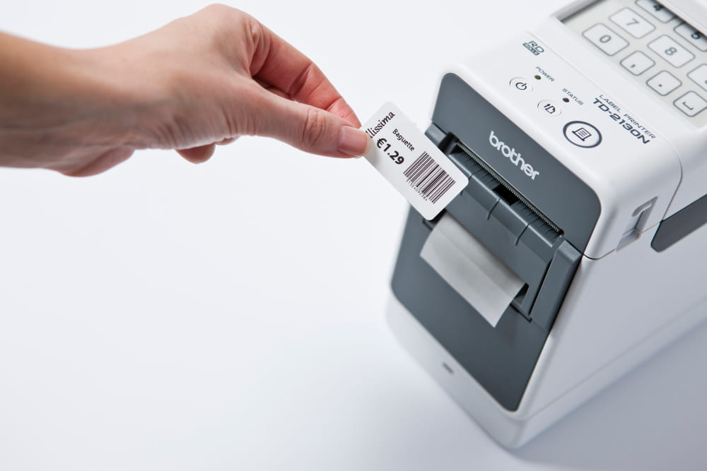 Price label containing barcode after printing on a Brother TD 2000 series label printer
