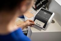 Nurse printing patient label using Brother TD-4420DN desktop label pritner