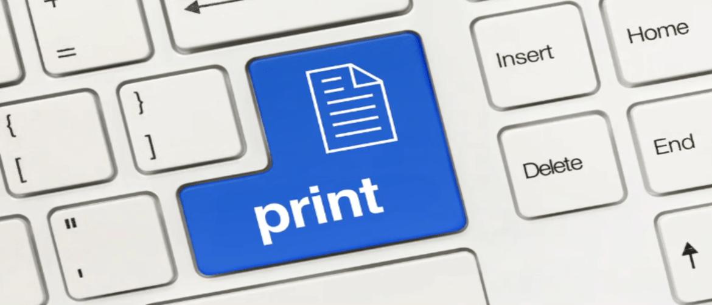 Gros plan sur un clavier d'ordinateur, la touche entrée portant l'inscription Printing.