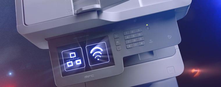 Imprimante multifonction professionnelle Brother MFC-L9570CDW avec icône réseau et WiFi sur écran tactile
